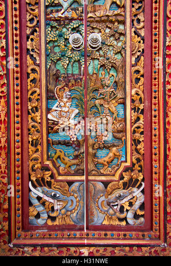 Indonesia Bali Lovina Anturan Village decoratively carved painted doors - Stock