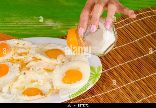 Heftily Salting Fried Eggs Unhealthy Stock Photos & Heftily ...