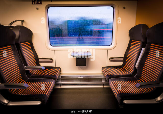 Inside modern train looking out of the window - Stock Image