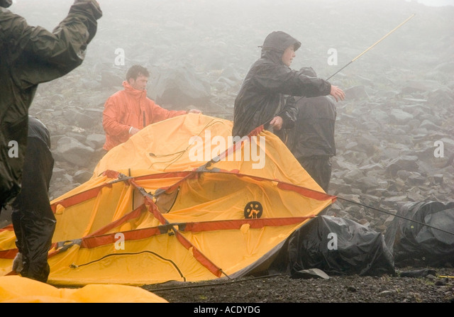Backpackers put up tent in the rain Lost Lake Chugach National Forest Kenai Peninsula Alaska summer & Put Up Tent Stock Photos u0026 Put Up Tent Stock Images - Alamy