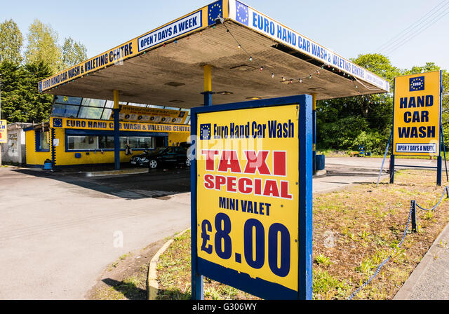 Car wash signs stock photos car wash signs stock images alamy signs at a euro hand car wash including one for a taxi special solutioingenieria Gallery