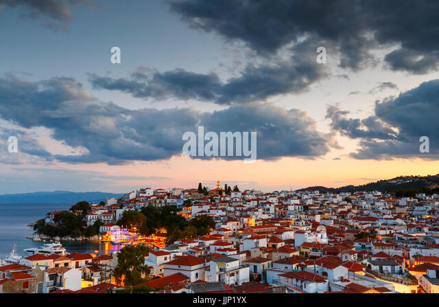Evening view of Skiathos town and its harbor, Greece. - Stock Image