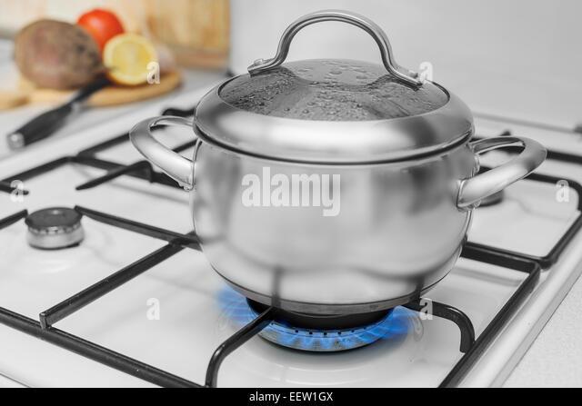 pot gas stove flame stock photos pot gas stove flame stock images alamy. Black Bedroom Furniture Sets. Home Design Ideas