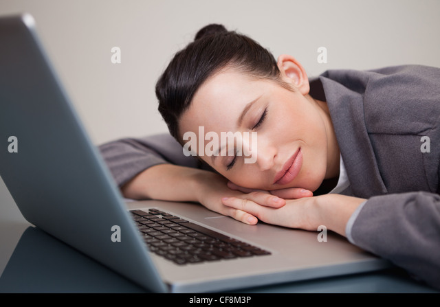 businesswoman taking a small nap on her laptop stock image business nap office relieve