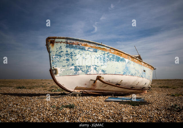 Derelict beached fishing boat - Stock Image