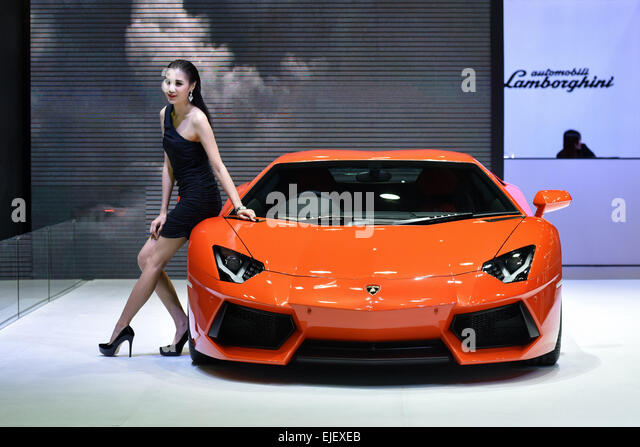 25th march 2015 a model poses with a red lamborghini - Sports Cars Lamborghini 2015