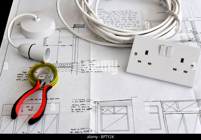 Construction building maintenance electrical stock photos blueprint plans of home building and construction with electrical items stock image malvernweather Images