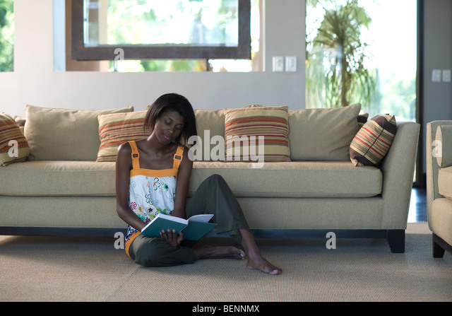 Barefooted couch stock photos barefooted couch stock for Young couple living room ideas
