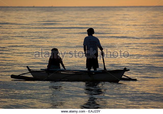Filipino fishermen in boat in stock photos filipino for Videos of people fishing