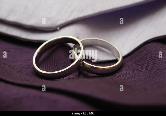silver wedding rings on lilac and purple cravats stock image - Gay Wedding Rings