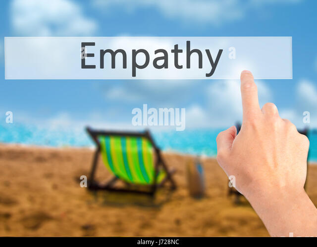 Empathy - Hand pressing a button on blurred background concept . Business, technology, internet concept. Stock Photo - Stock Image