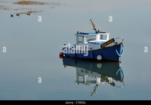Boat for sale stock photos boat for sale stock images for Small motor boat for sale