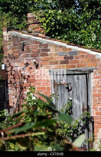 Brick garden shed stock photos brick garden shed stock for Brick garden shed designs