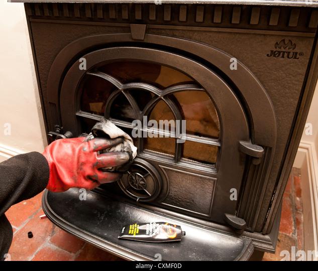 Blacking a wood burning stove - Stock Image - Blacking Stock Photos & Blacking Stock Images - Alamy