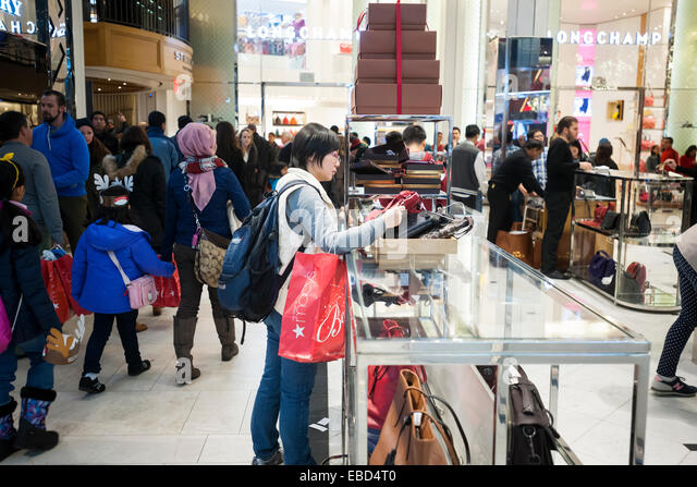 coach usa outlet sale 6a7b  New York, USA 28th November, 2014 A shopper browses Coach handbags in