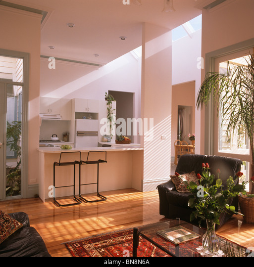 Large open plan living room and kitchen with stools at breakfast bar  Stock Image Open Plan Kitchen Living Photos