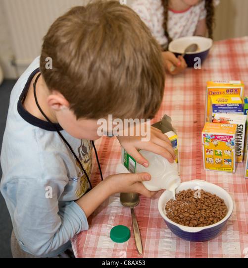 Children Pouring Milk Stock Photos & Children Pouring Milk ...