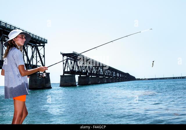 Taking kids fishing stock photos taking kids fishing for Florida keys bridge fishing