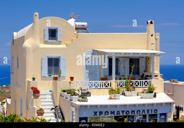 Traditional Greek Houses traditional greek house flowers stock photos & traditional greek