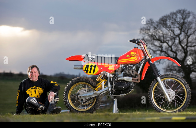 twin shock vintage motocross rider stockfotos twin shock. Black Bedroom Furniture Sets. Home Design Ideas