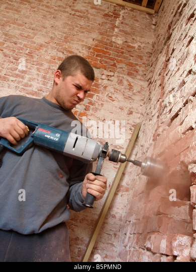 hole in brick wall stockfotos hole in brick wall bilder alamy. Black Bedroom Furniture Sets. Home Design Ideas