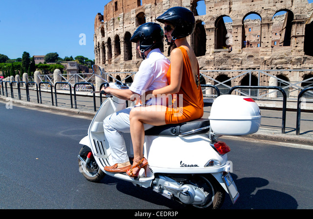 couple with vespa stockfotos couple with vespa bilder. Black Bedroom Furniture Sets. Home Design Ideas