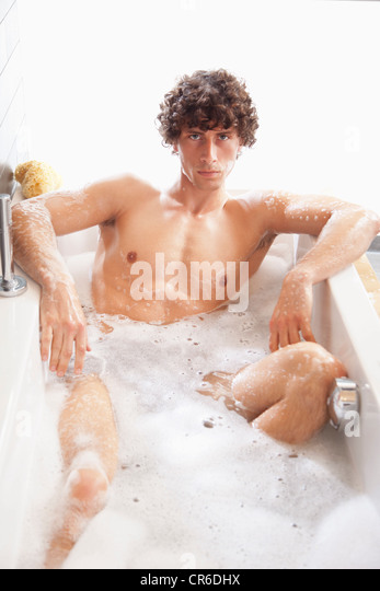 man having bubble bath in stockfotos man having bubble bath in bilder alamy. Black Bedroom Furniture Sets. Home Design Ideas