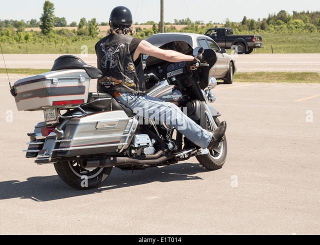 biker wearing harley davidson leather stockfotos biker. Black Bedroom Furniture Sets. Home Design Ideas