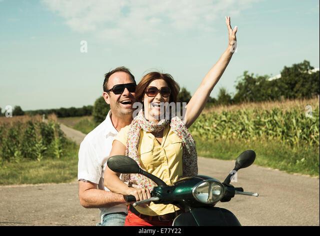Couple With Vespa Stockfotos Couple With Vespa Bilder