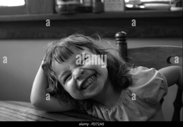 girl leaning on chair stockfotos girl leaning on chair bilder alamy. Black Bedroom Furniture Sets. Home Design Ideas